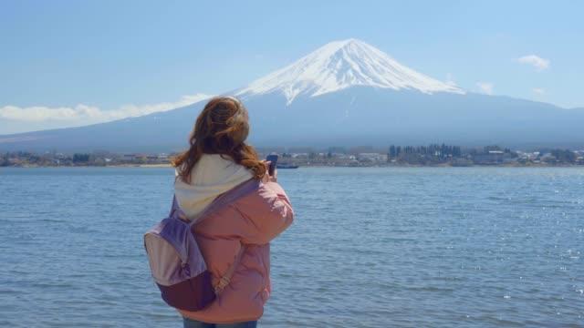 beautiful women taking photos of mt.fuji - satoyama scenery stock videos & royalty-free footage