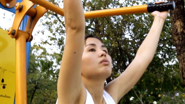 Beautiful Women Weightlifting In Public Park