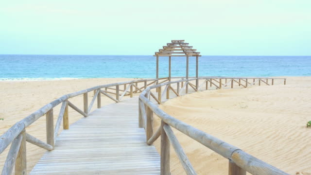 Beautiful wood gangway in delightful beach with nobody