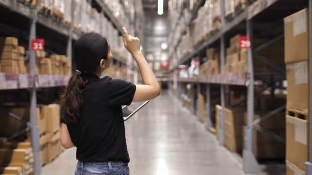 beautiful worker using tablet in warehouse - stationary stock videos & royalty-free footage