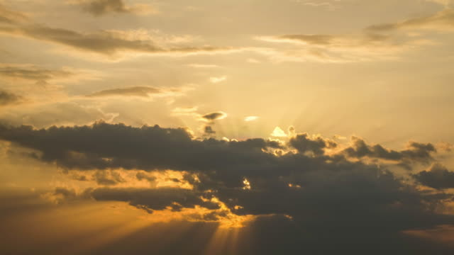 beautiful yellow cloudscape with sunlight beams - heat haze stock videos & royalty-free footage
