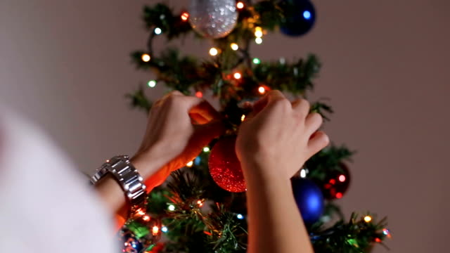 beautiful youg woman decorating the christmas tree - fir tree stock videos & royalty-free footage