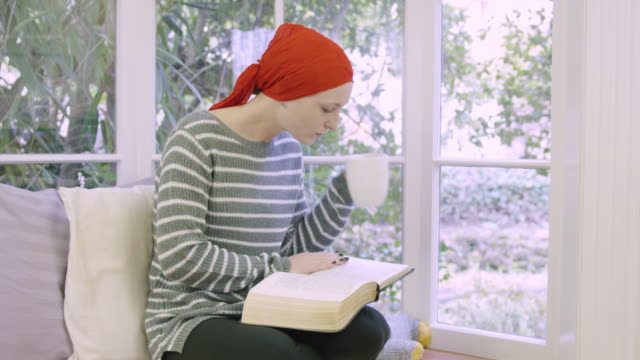 beautiful young adult female with breast cancer - hair loss stock videos & royalty-free footage