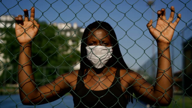 beautiful young african ethnicity woman with protective face mask-no racism and human rights concept - protest stock videos & royalty-free footage