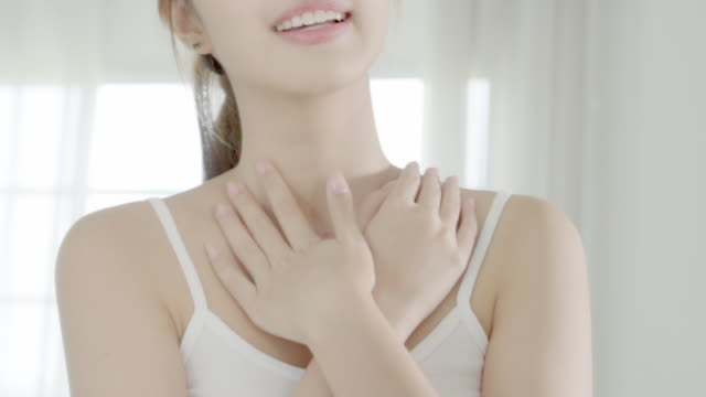 beautiful young asian woman looking mirror and apply lotion sunscreen with neck, beauty asia girl perfect with skin care and health with cream treatment and moisturizer, wellness and health care concept. - neck stock videos & royalty-free footage