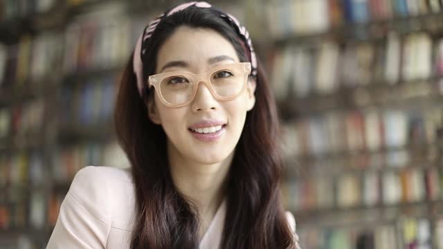 Beautiful young Asian woman reading a book
