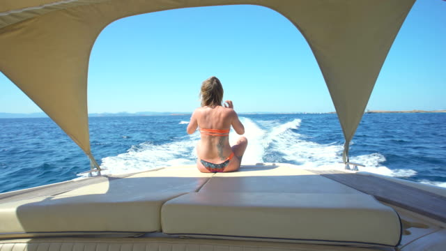 beautiful young blonde woman relaxed in a yatch - bikinihose stock-videos und b-roll-filmmaterial