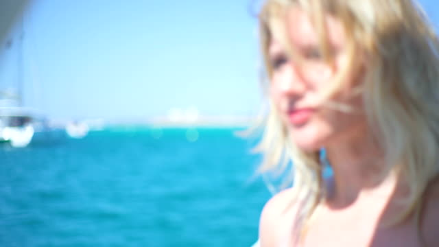 Beautiful young blonde woman relaxed in a yatch