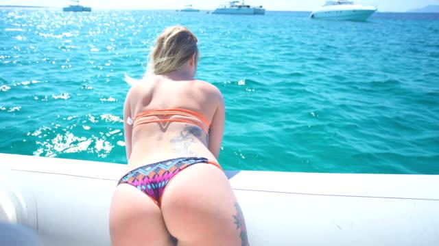 beautiful young blonde woman with great bikini bottom - bikinihose stock-videos und b-roll-filmmaterial