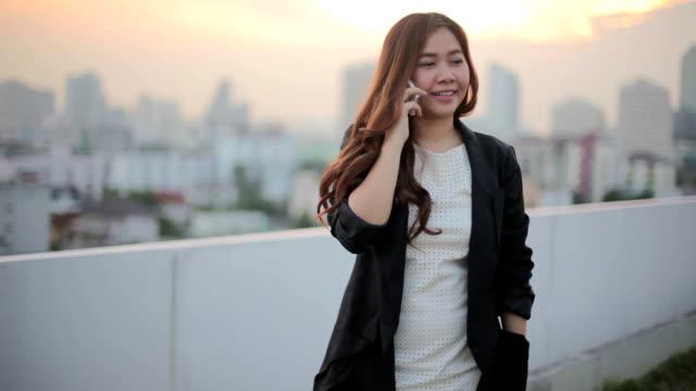 Beautiful young business asian woman using a smart phone