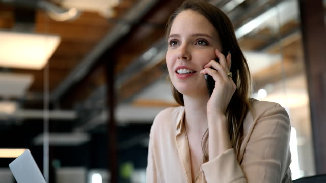 beautiful young businesswoman talking mobile phone - new business stock videos & royalty-free footage