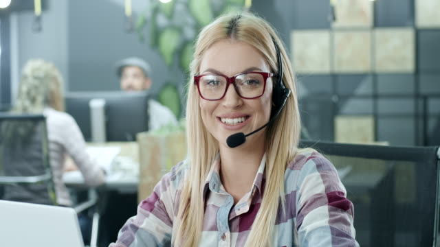 beautiful young call-centre assistant - outsourcing stock videos & royalty-free footage
