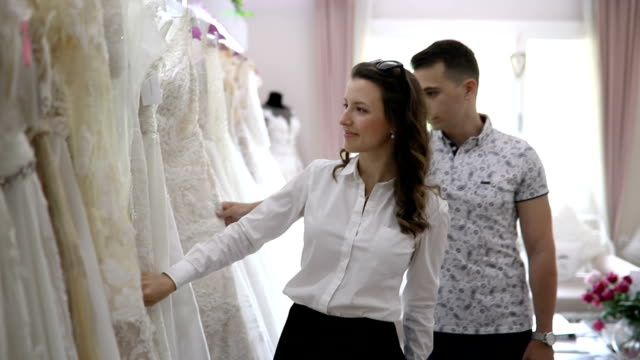 Beautiful young couple at the bridal shop