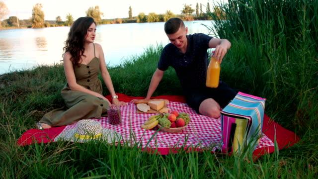 Beautiful young couple on picnik blanket