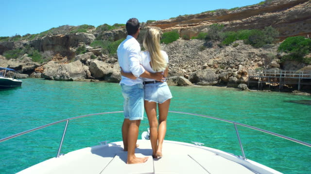 Beautiful young couple relaxed in yatch