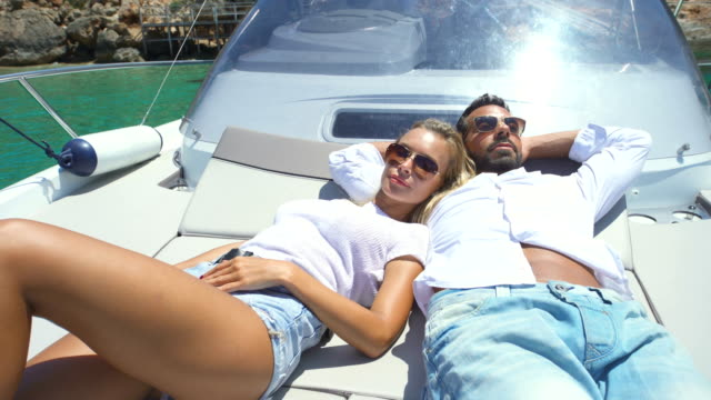 beautiful young couple relaxed in yatch - silvestre stock videos & royalty-free footage