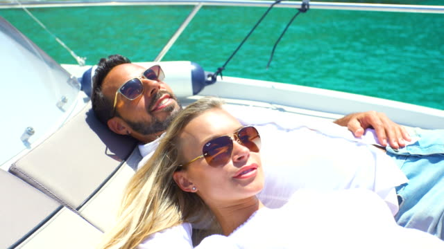 beautiful young couple relaxed in yatch - handsome people stock videos & royalty-free footage