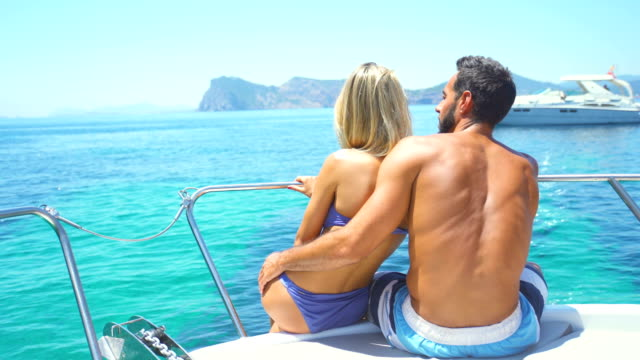 stockvideo's en b-roll-footage met beautiful young couple relaxed in yatch - silvestre