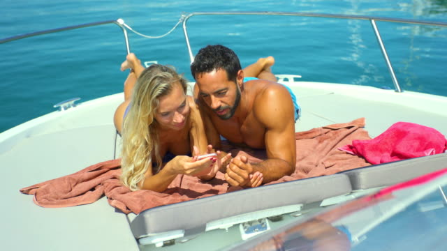 beautiful young couple relaxed in yatch - swimwear stock videos & royalty-free footage