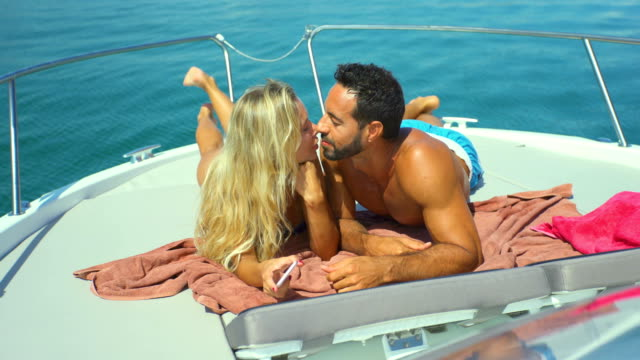 beautiful young couple relaxed in yatch - halbbekleidet stock-videos und b-roll-filmmaterial