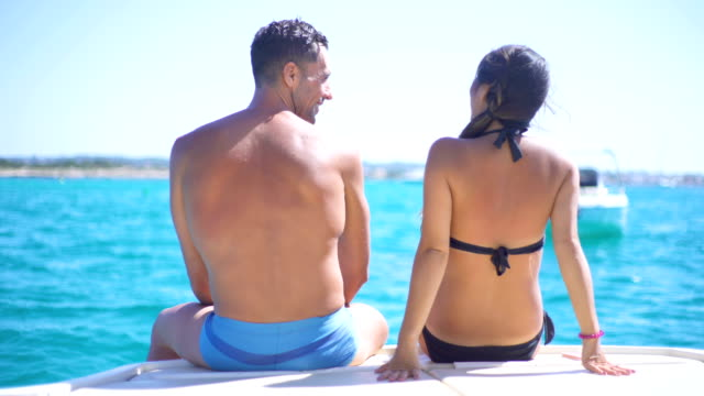 beautiful young couple relaxed in yatch - men's underpants stock videos and b-roll footage