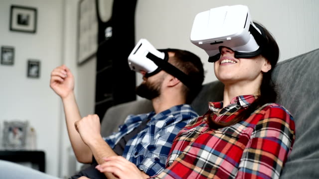 beautiful young couple with glasses of virtual reality