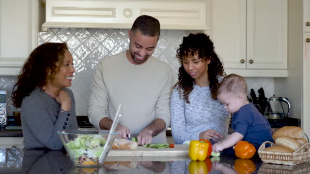 Beautiful Young family Cooking With Their Baby