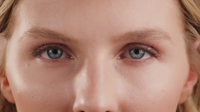 beautiful young female having gray eyes - body care stock videos & royalty-free footage
