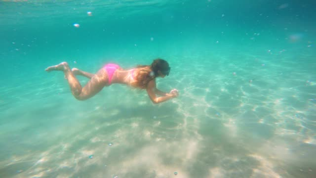beautiful young girl diving underwater - swimwear stock videos & royalty-free footage