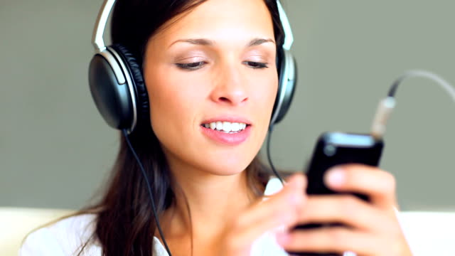Beautiful young lady listening to music