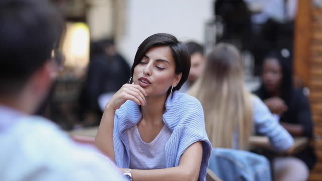 beautiful young lady sitting in cafe outdoors - after work stock videos & royalty-free footage