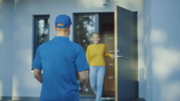 Beautiful Young Smiling Woman Opens Doors of Her House and Meets Pizza Delivery Guy who Gives Her Cardboard Boxes Full of Tasty Steamy Pizza. Back View Following Shot