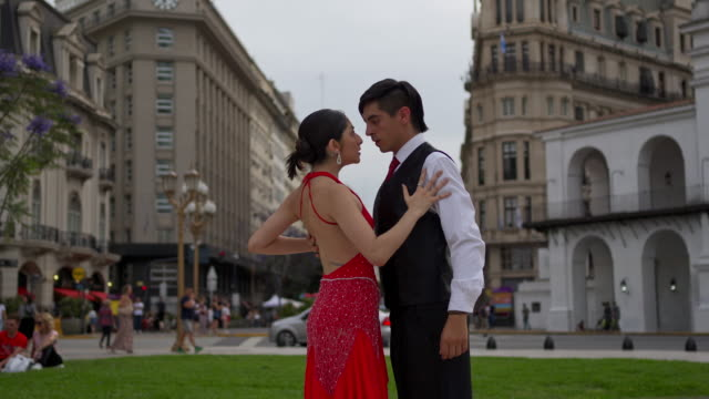 beautiful young tango dancing couple dancing on a town square - argentinian culture stock videos & royalty-free footage