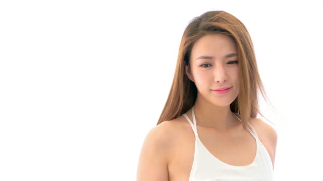 ms beautiful young woman against white background - straight hair stock videos & royalty-free footage