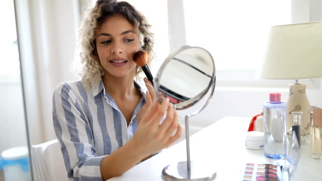 beautiful young woman applying make up - make up brush stock videos and b-roll footage