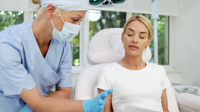beautiful young woman at beauty clinic - clostridium botulinum stock videos & royalty-free footage