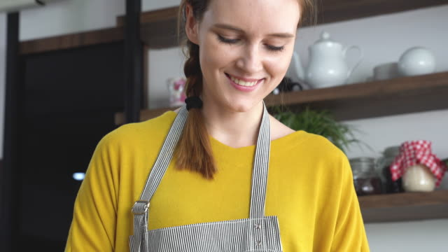a beautiful young woman cutting vegetables - kitchenware department stock videos and b-roll footage