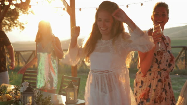 beautiful young woman dancing at sunset - white wine stock videos & royalty-free footage