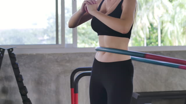 beautiful young woman doing a beautiful figure in the gym - stretching stock videos & royalty-free footage
