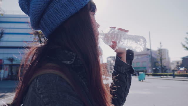 beautiful young woman drinking water out of glass. - bottle stock videos & royalty-free footage
