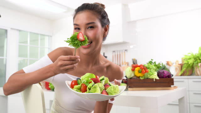 beautiful young woman eating salad - kitchenware shop stock videos & royalty-free footage
