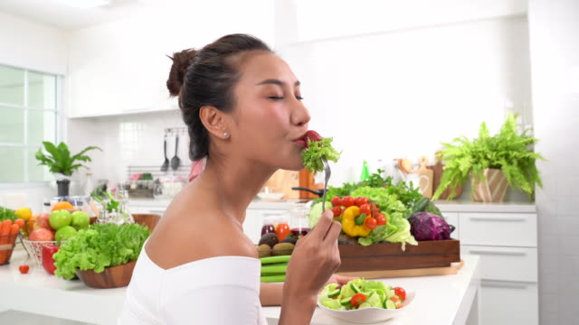 beautiful young woman eating salad - kitchenware department stock videos and b-roll footage