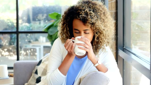 beautiful young woman enjoys morning coffee - cosy stock videos & royalty-free footage