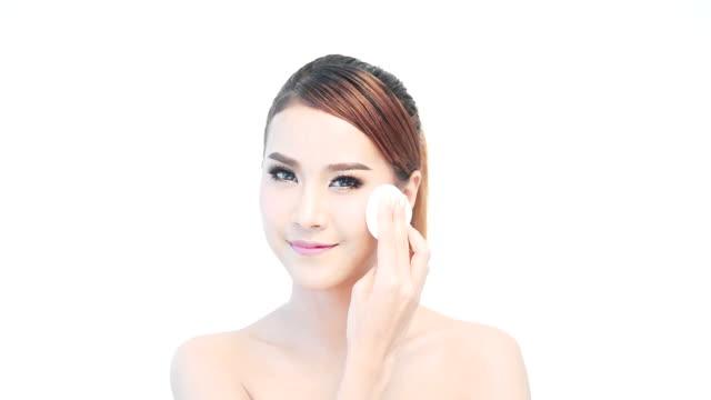 Beautiful young woman face close up.