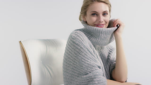 beautiful young woman feeling cozy in sweater - jumper stock videos and b-roll footage