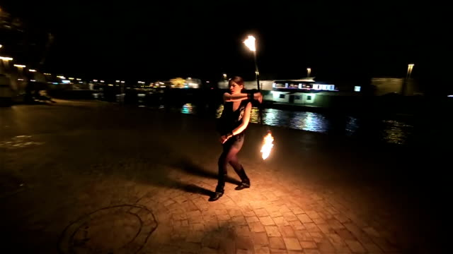 beautiful young woman have performance with fire,camera stabilization shoot