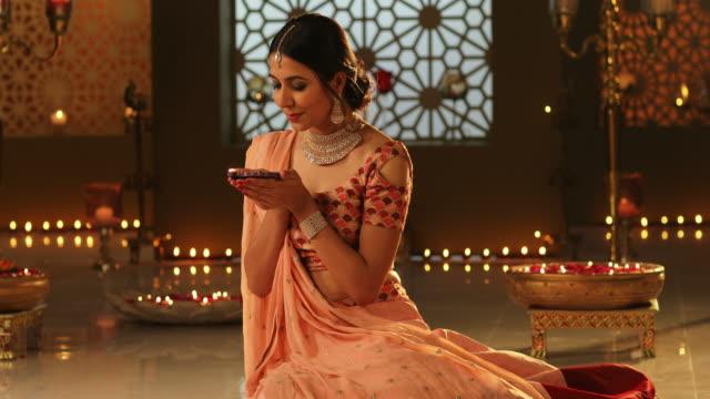 MS TU Beautiful young woman holding a diya during Diwali festival / New Delhi, Delhi, India