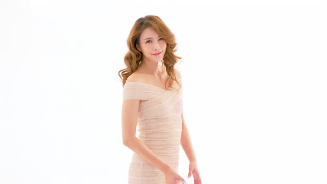 MS Beautiful young woman holding gift against white background, Bejing