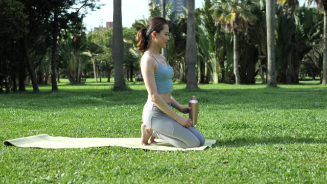 beautiful young woman in asia exercise yoga and resting in lotus position - siddhasana - lap body area stock videos & royalty-free footage