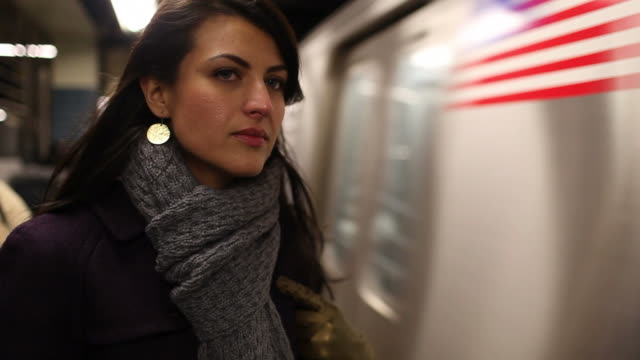 beautiful young woman in new york city subway, copy space - subway station stock videos & royalty-free footage